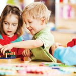 IELTS Writing: Who will look after children?